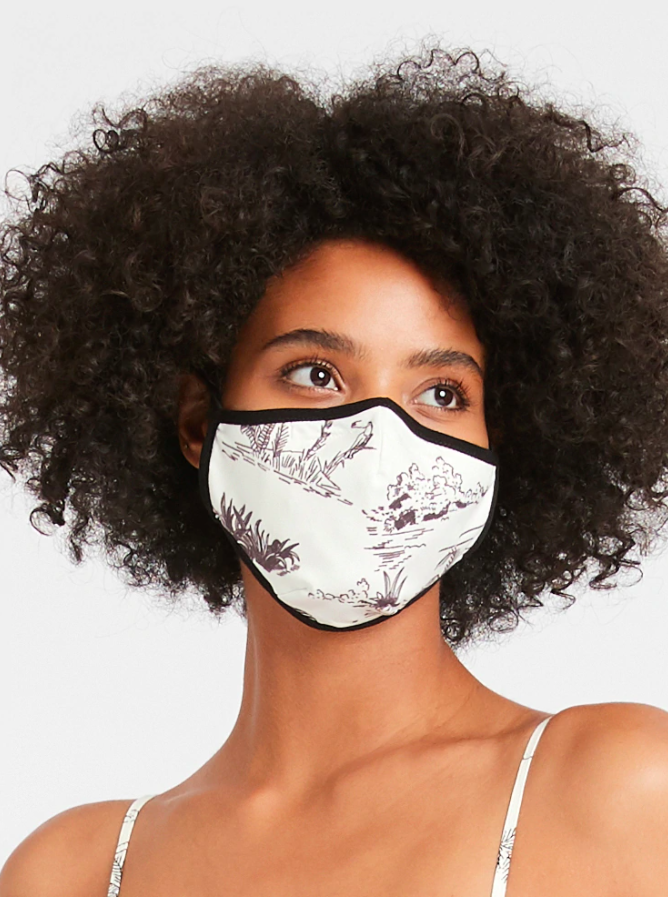 model wearing the mask in white