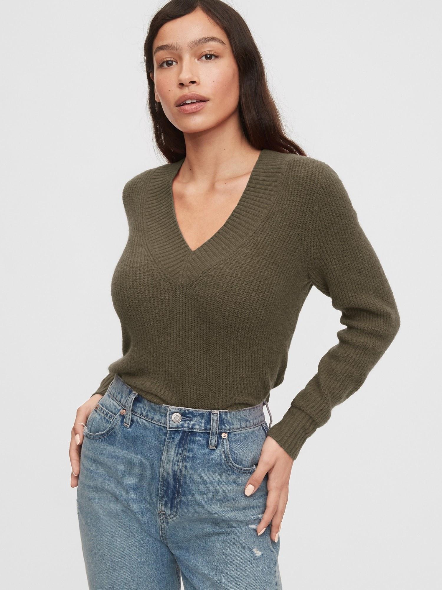 model wearing v-neck sweater in olive green