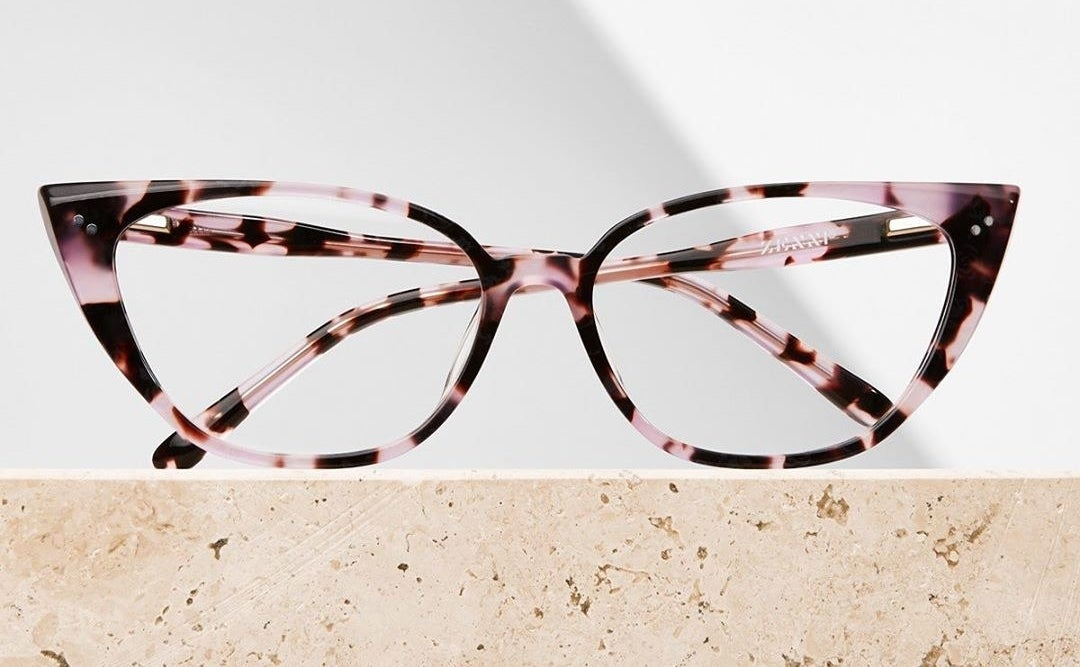 the pink and black cat eye frames