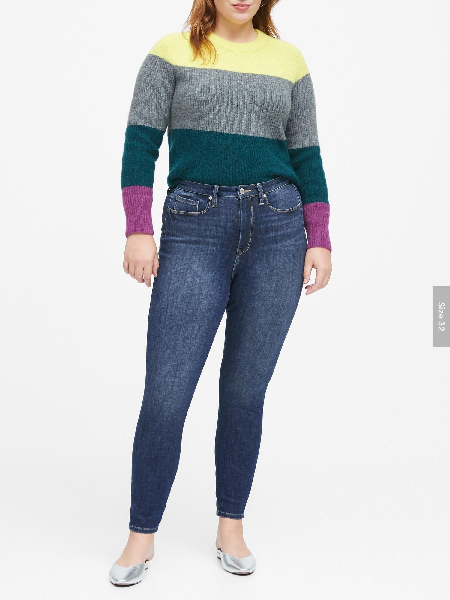 Model wearing the jeans in a medium denim wash
