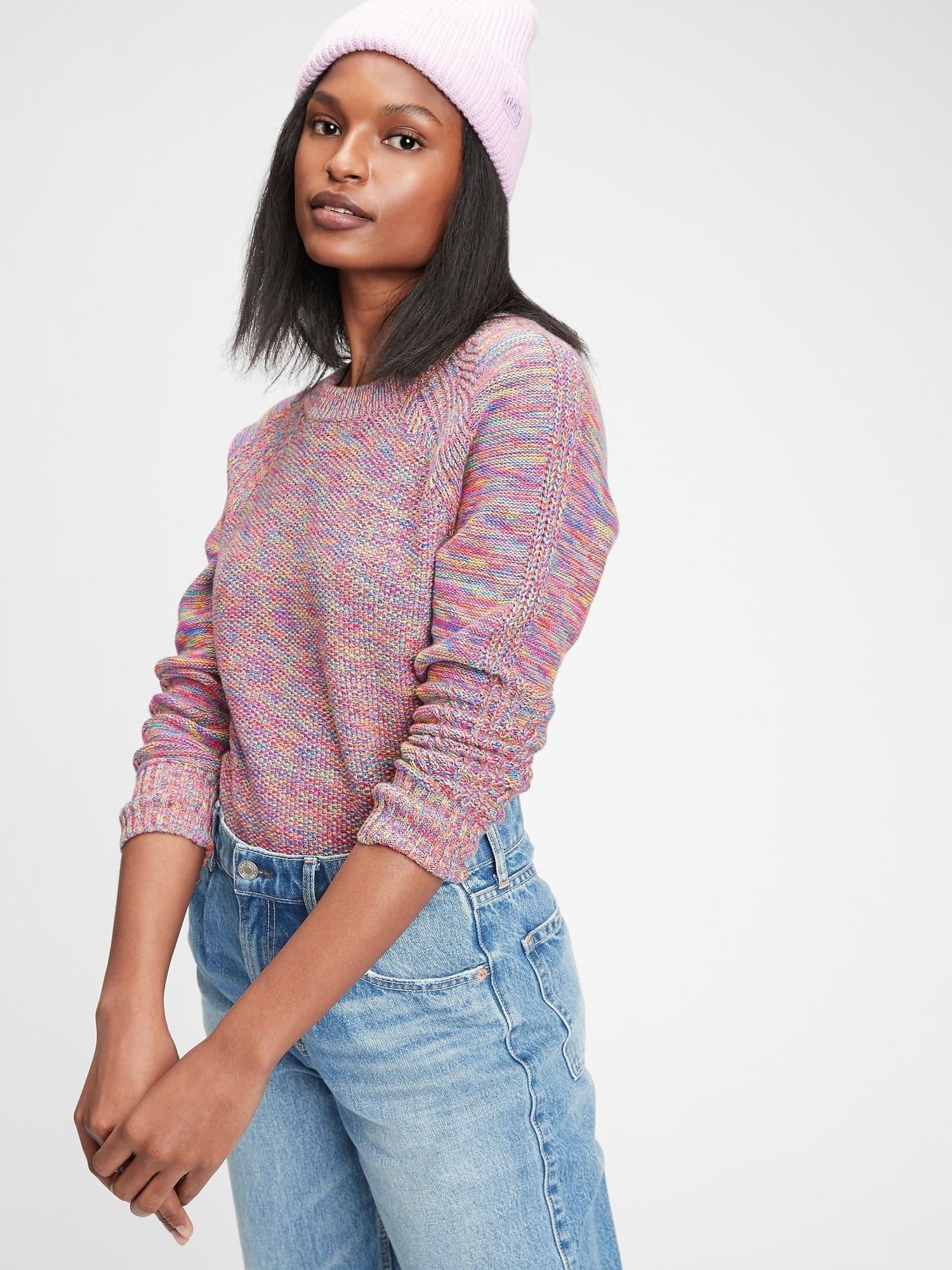 model wearing textured crewneck sweater in multicolor