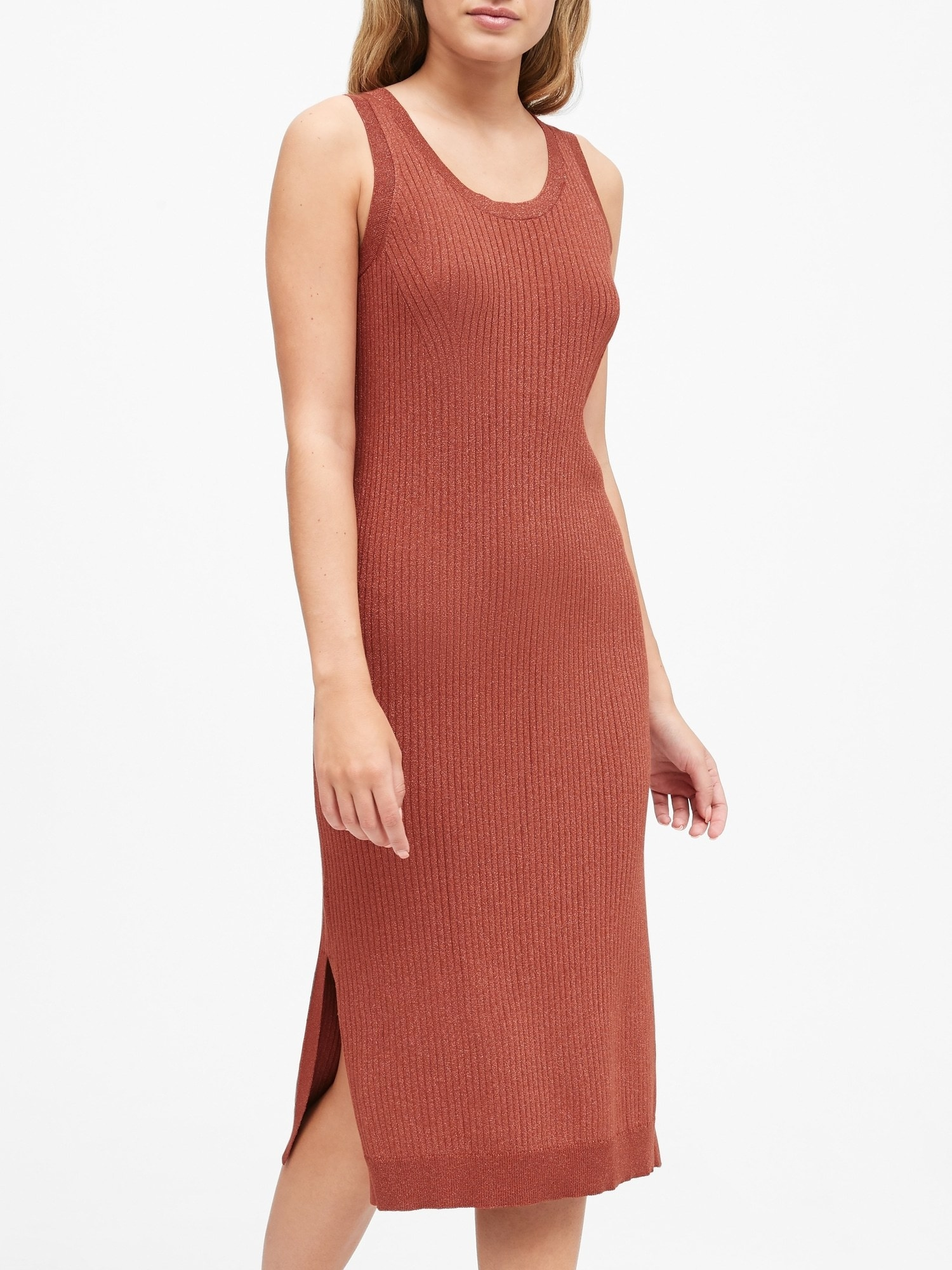 Model wearing the knit dress with small slits up the side in orange