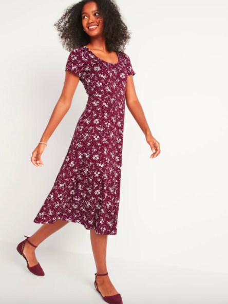 model wearing burgundy midi dress with white floral pattern