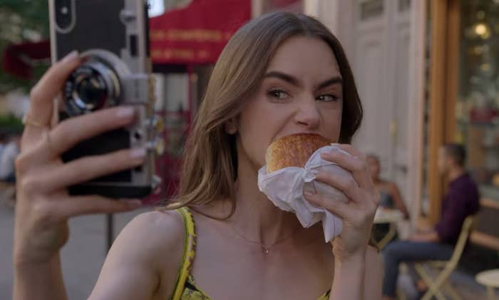 "Emily eating a croissant on ""Emily In Paris"""
