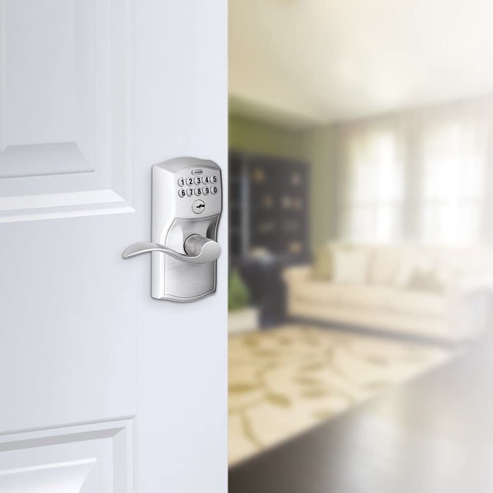 A close up of the keypad lock on a front door