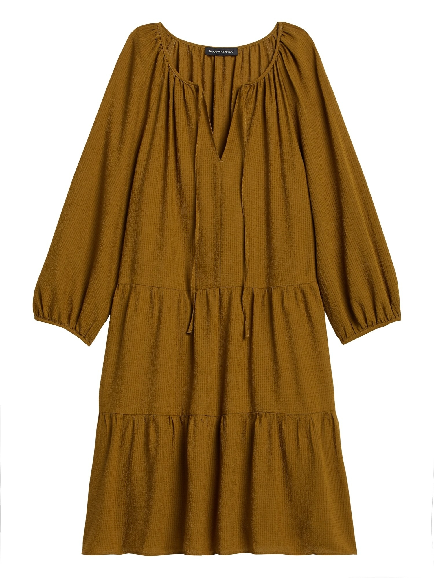 The 3/4-sleeved dress with three tiers, balloon sleeves, v-neck, and ties in green