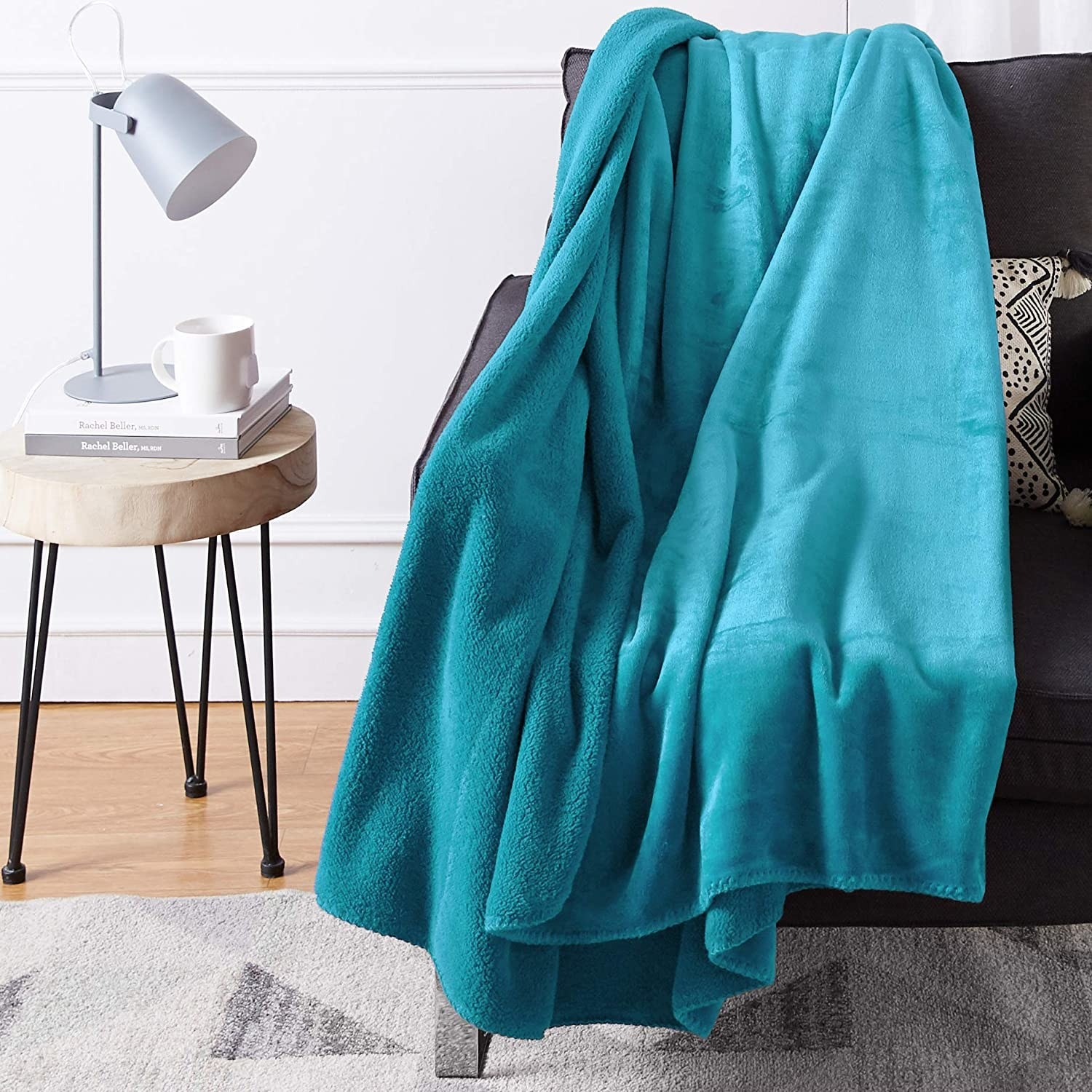 The fuzzy blanket draped artfully over a couch