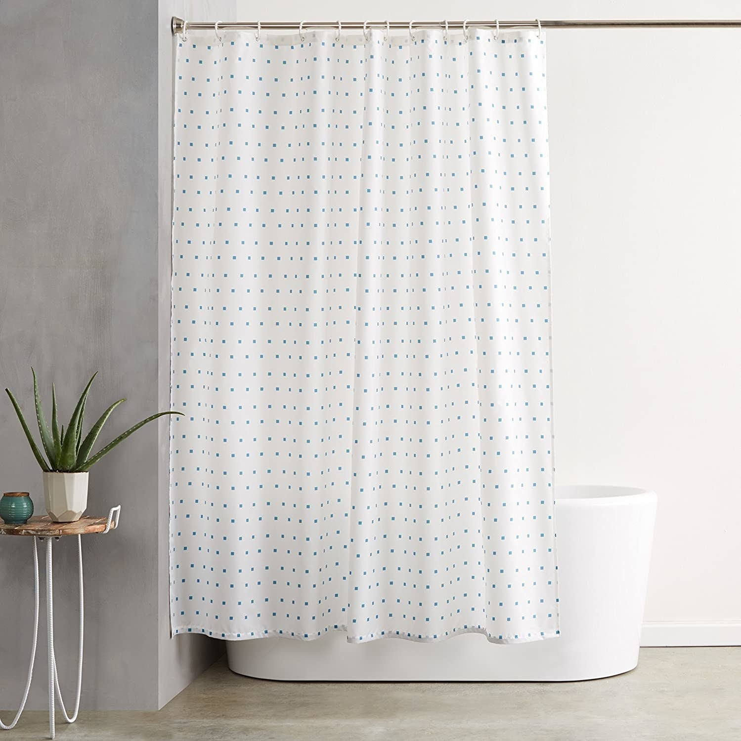 The shower curtain covering a free-standing tub