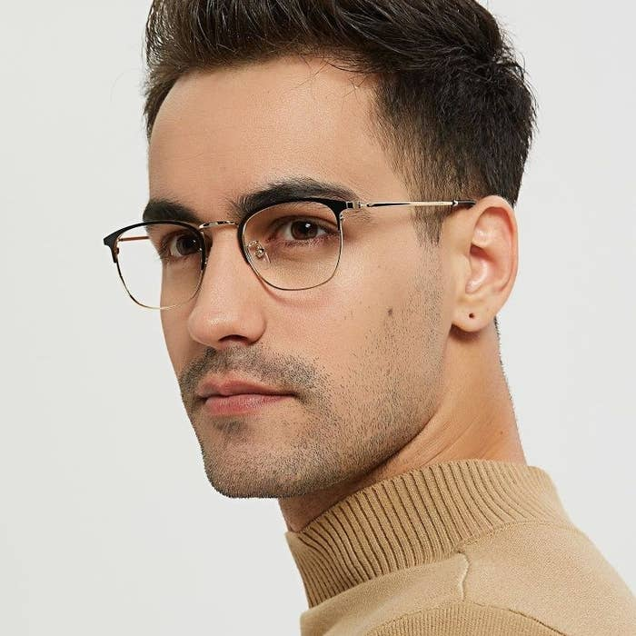 model wearing the black and gold glasses