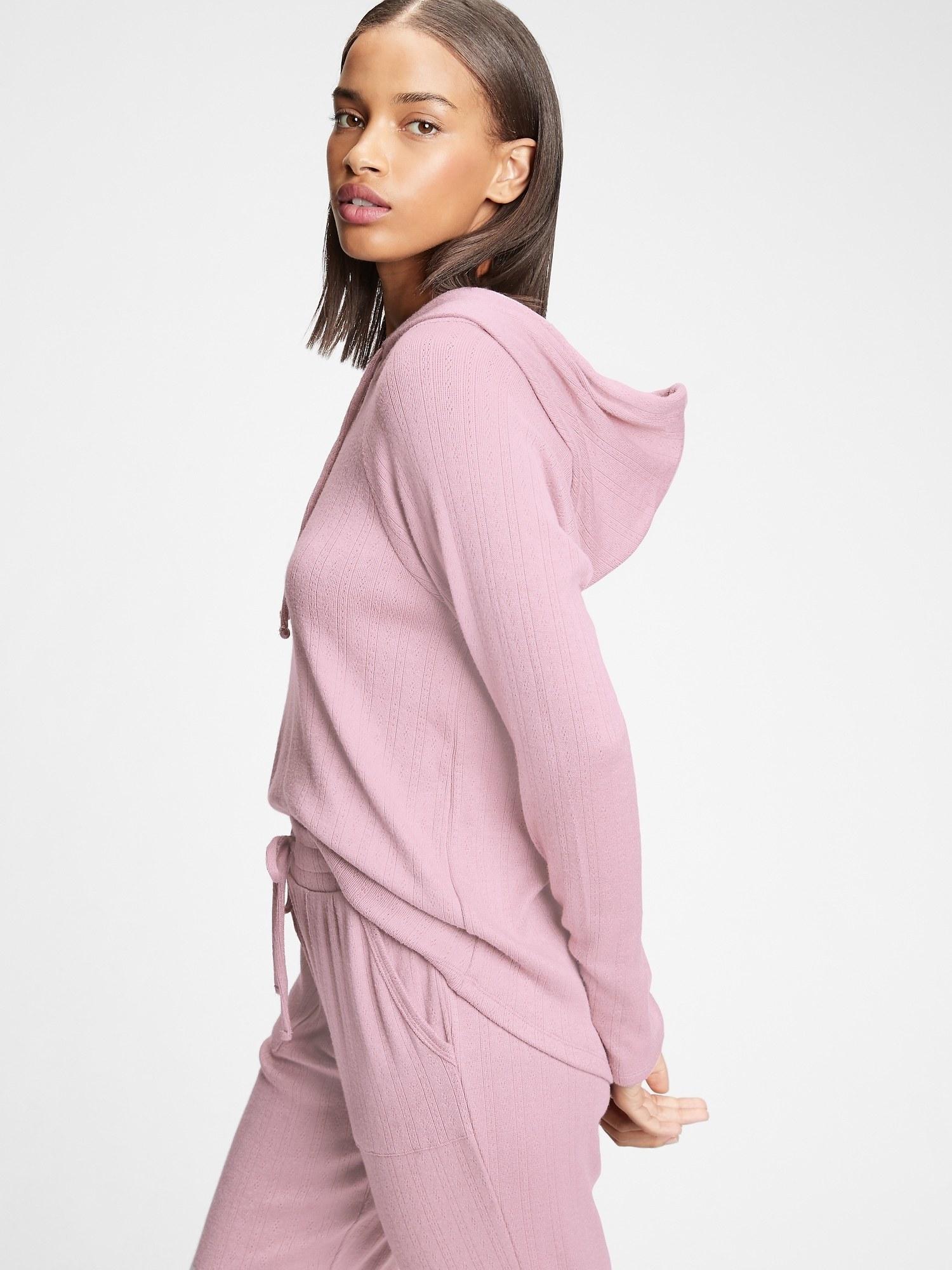 model wearing softspun hoodie in elderberry pink