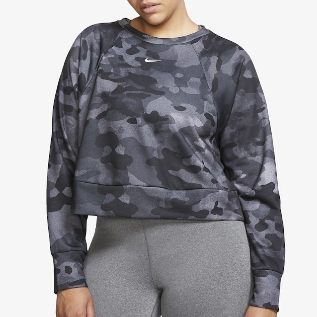 A model wearing the black Nike camo crew neck