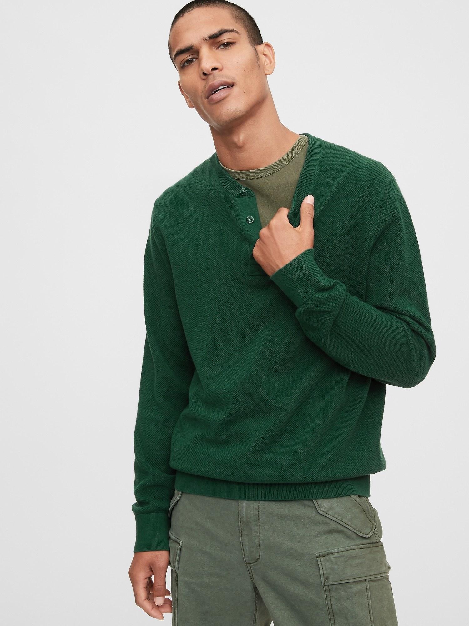 model wearing mainstay henley sweater in pine green