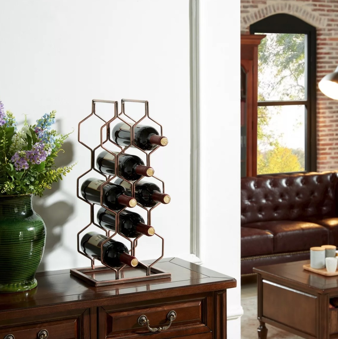 A brass-colored tabletop wine rack