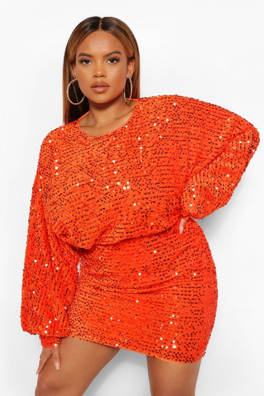 plus size model with red sequins, elastic waist, and large sleeves