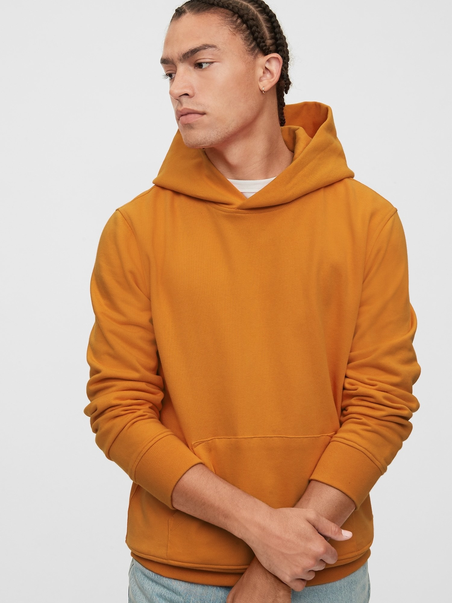 model wearing vintage soft hoodie in autumn orange