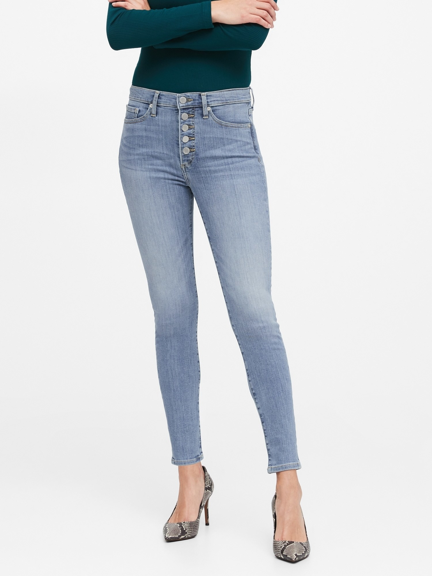 Model wearing the jeans in a light denim wash