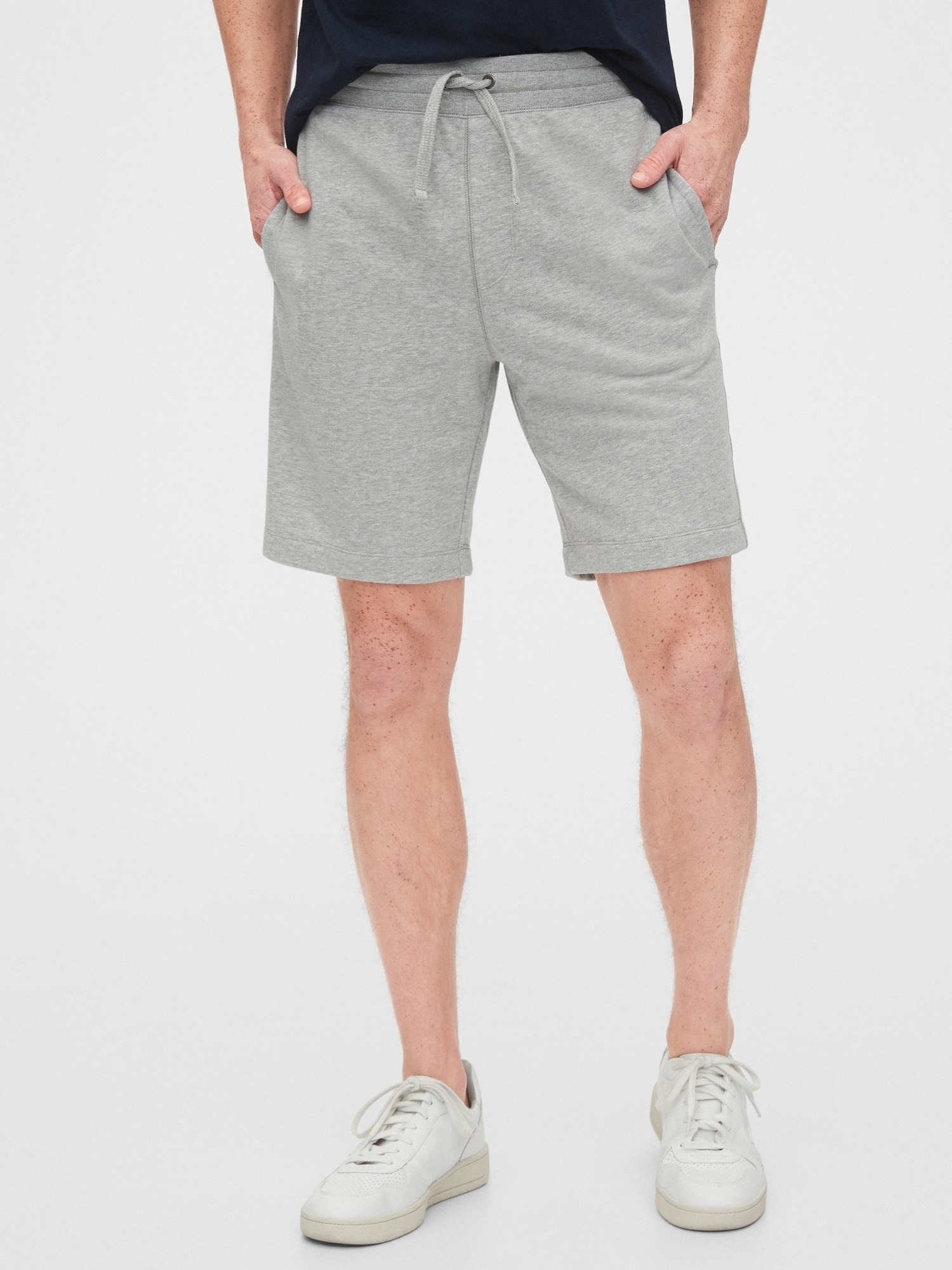 Model wearing jogger shorts in heather grey