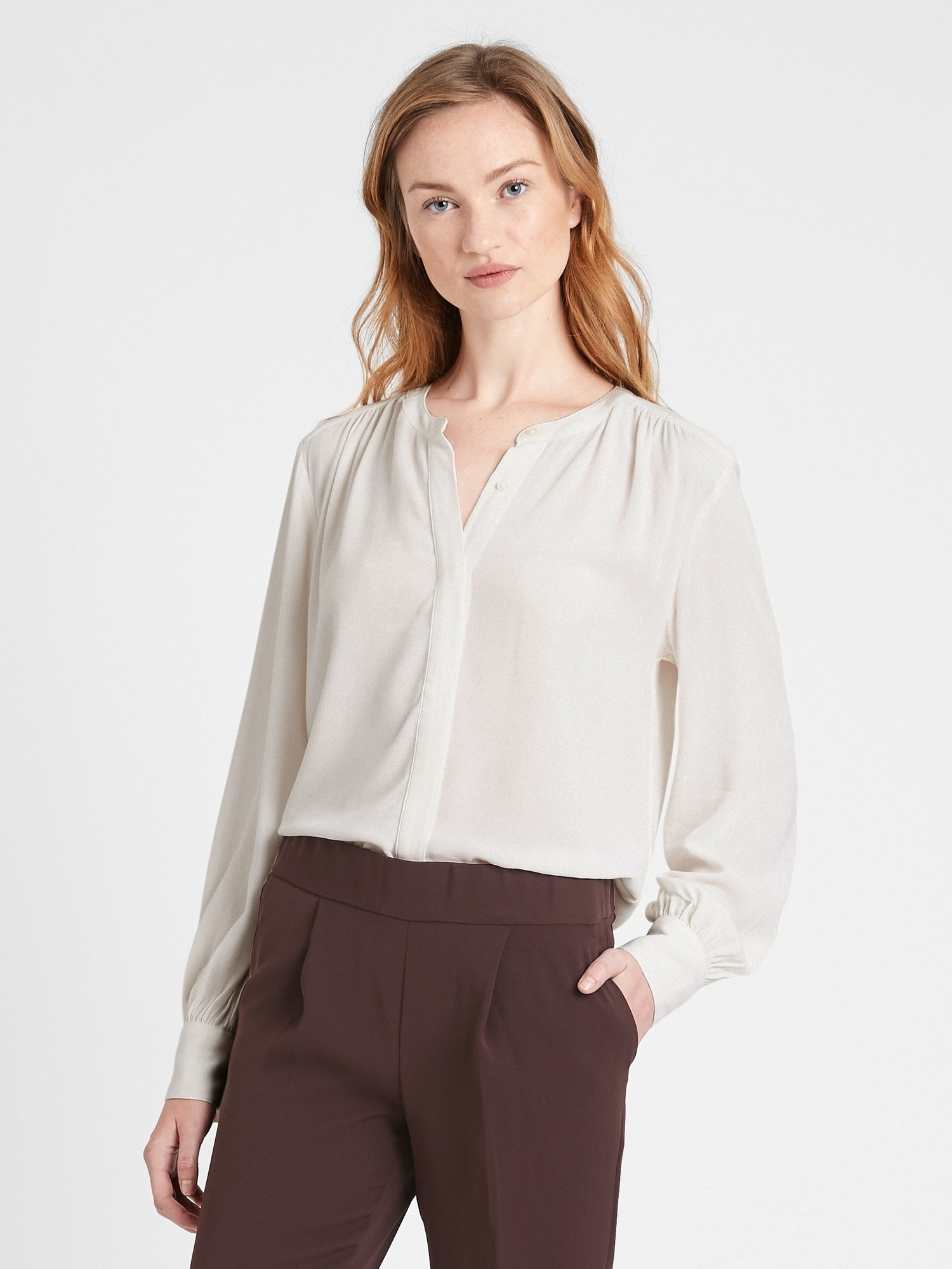 Model wearing the blouse in white