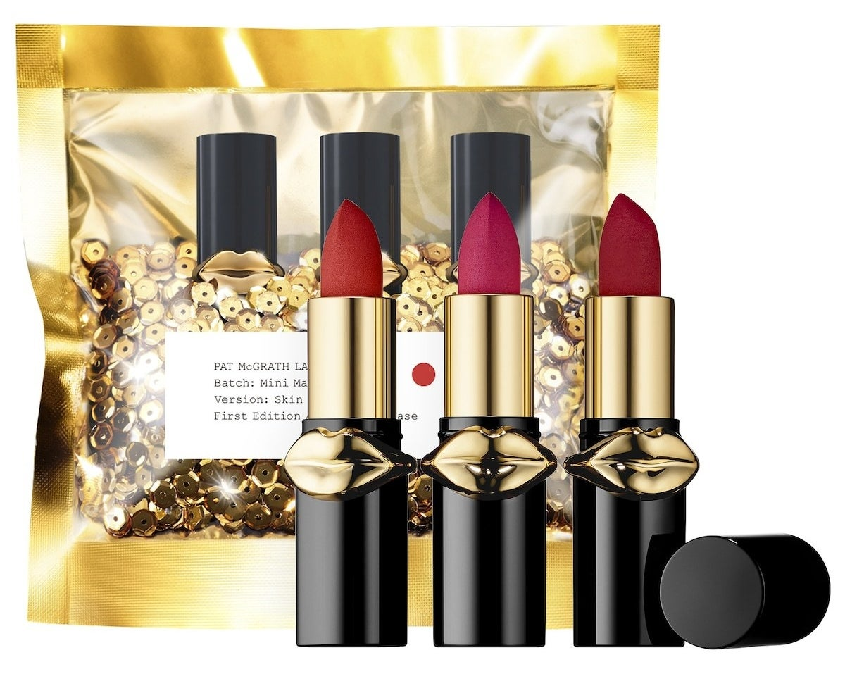 The lipsticks in reds, dark pink, and burgundy with the gold sequin packaging
