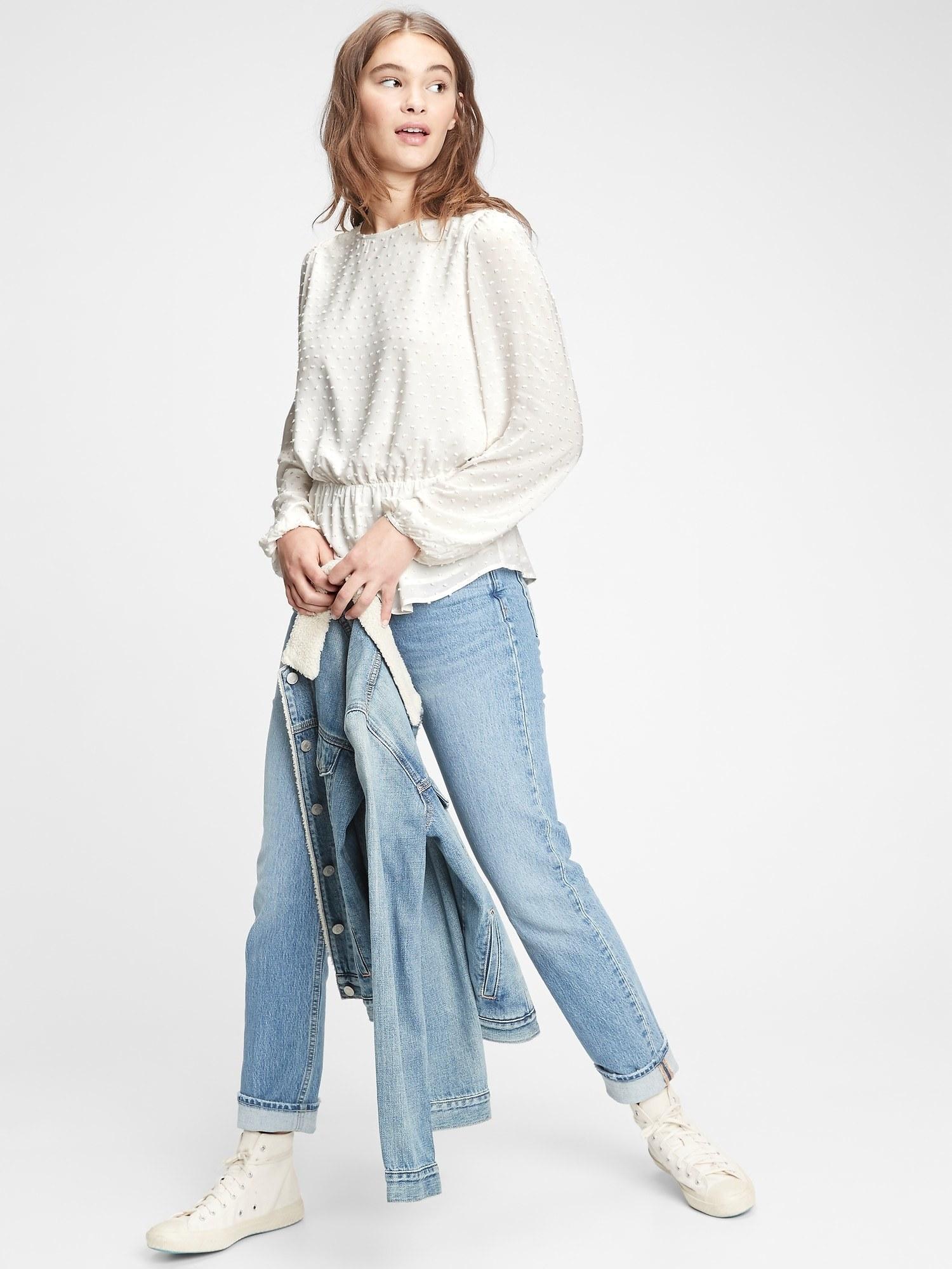 Model wearing peplum top