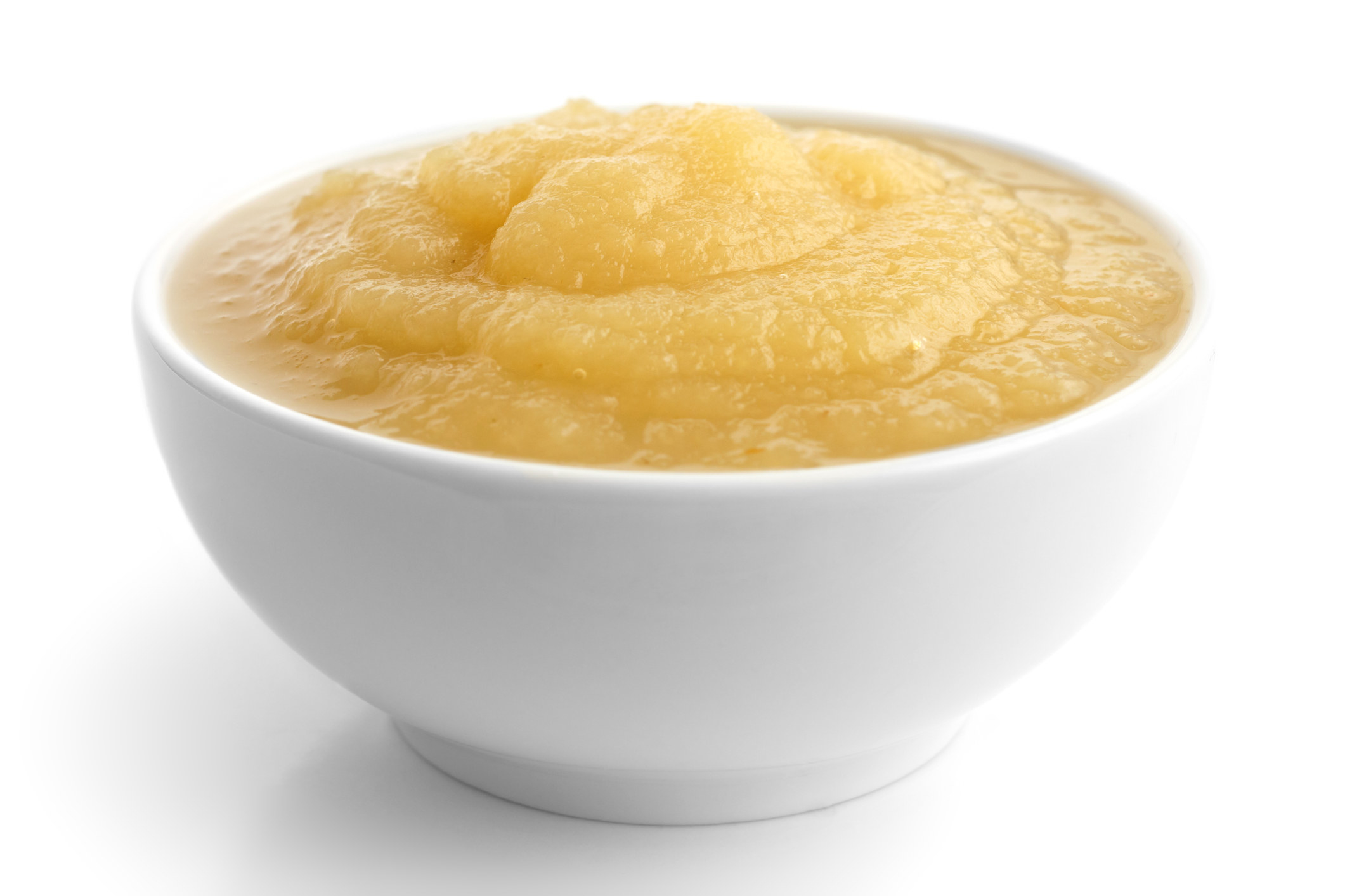 A small white bowl of apple sauce.