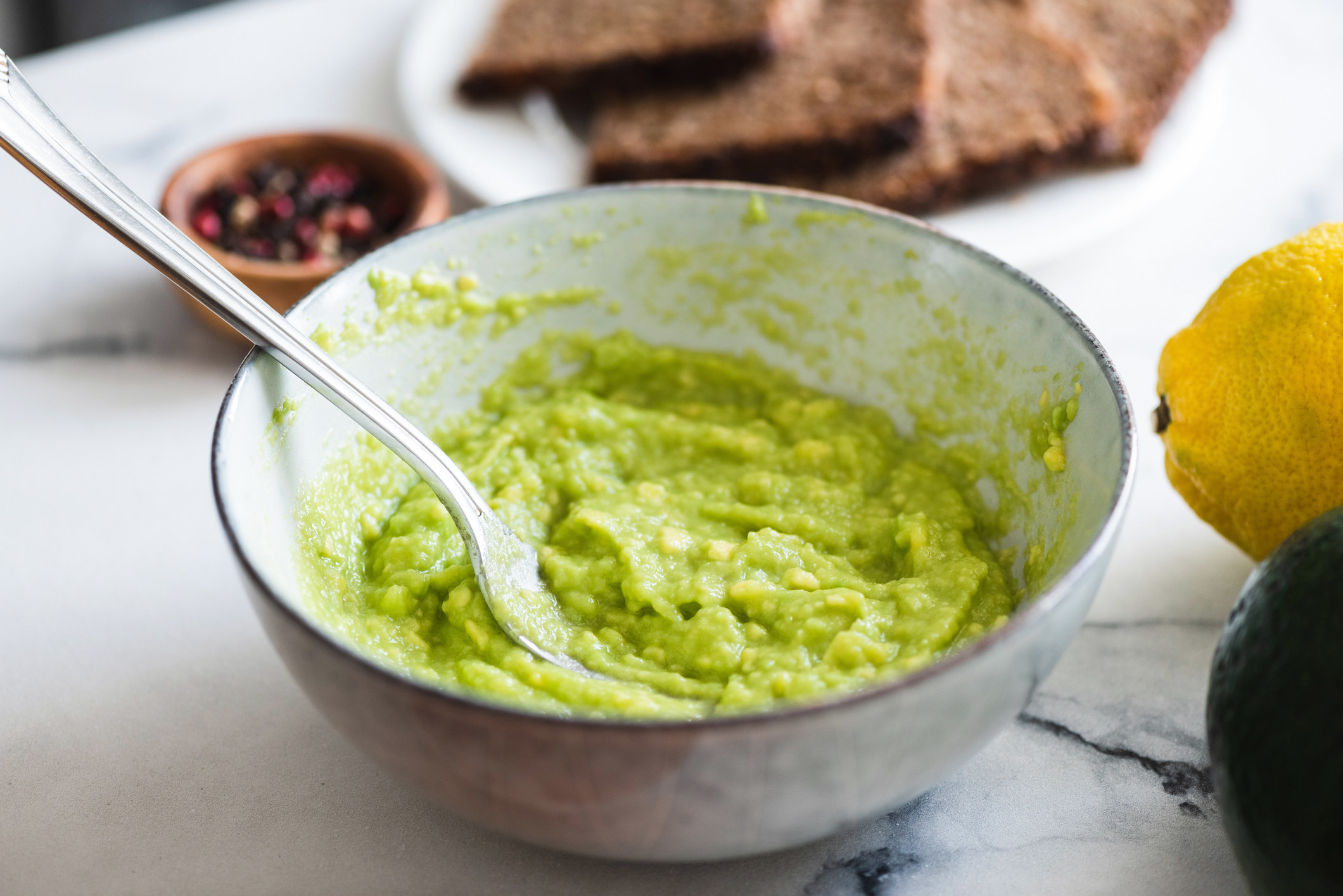 A bowl of mashed avocado.
