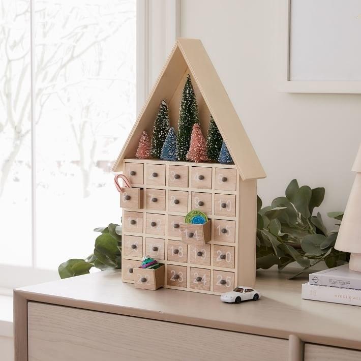 the light wooden house-shaped advent calendar