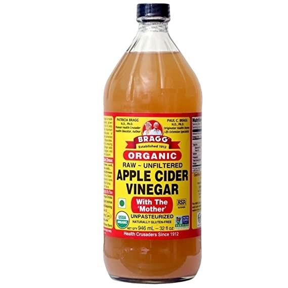 A bottle of Bragg organic apple cider vinegar.