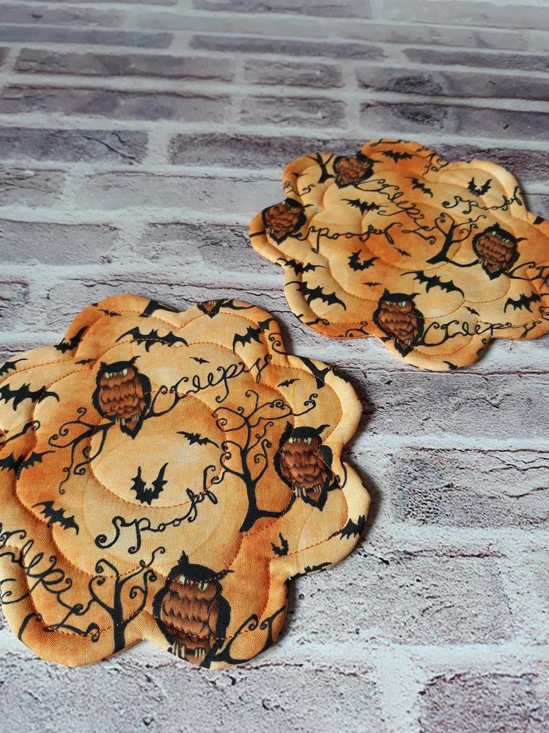 Two drink coasters with bats and owls