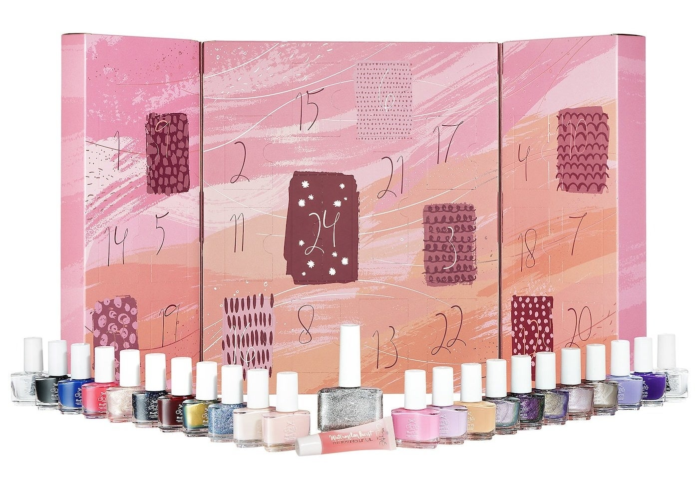 about 20 tiny nail polish bottles lined up in front of the pink adcent calendar