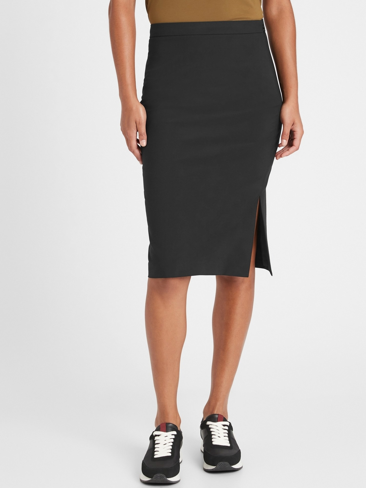 Model wearing the pencil skirt with a side slit in black