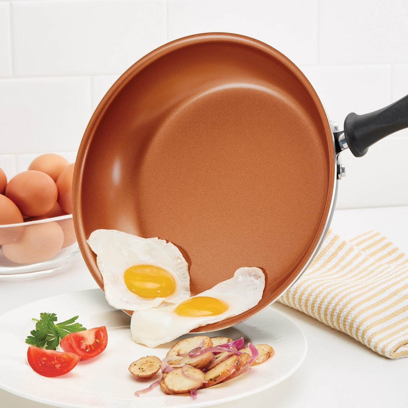 The nonstick pan with eggs easily slipping off onto a plate