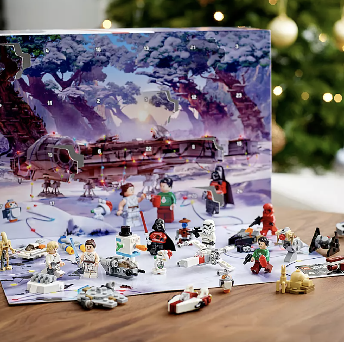 the advent calendar which depicts a festive star wars scene behind an array of the lego figures found in the calendar