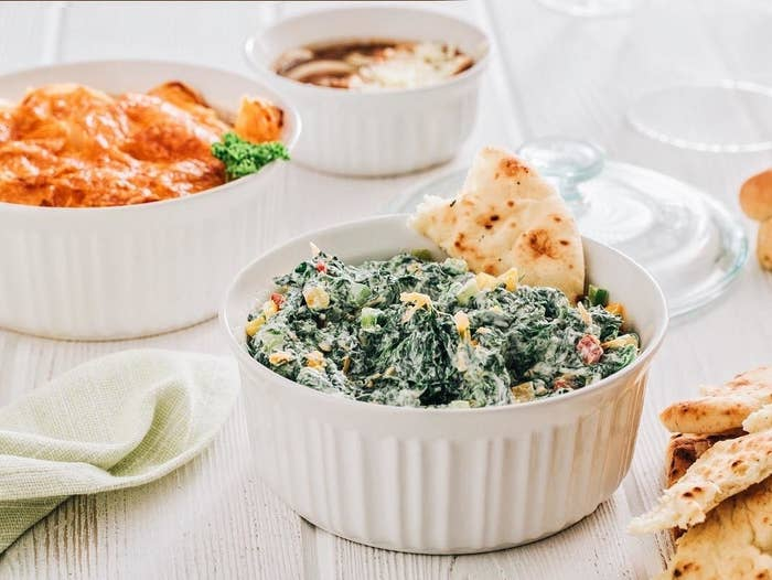 The casserole dish holding a spinach dip
