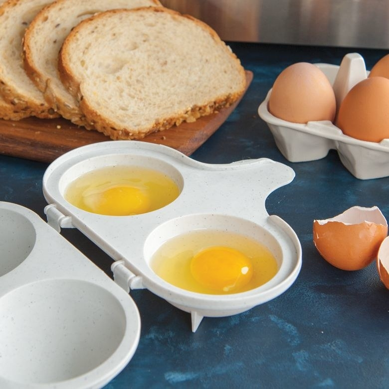 The egg poacher with two yolks in it