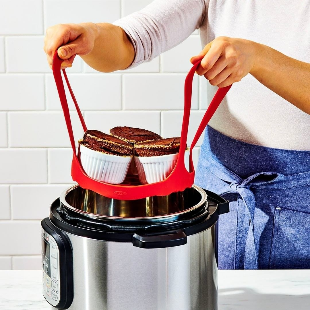 Person using the bakeware sling to make souffles