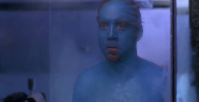 """Paul Giamatti stands in the bathroom and looks at himself in the mirror and sees his skin has been dyed blue as Marty in """"Big Fat Liar"""""""