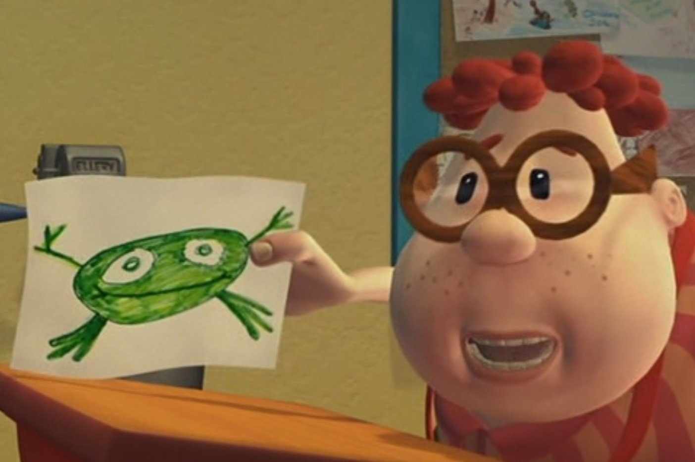 Carl Wheezer holds up a picture of a frog that he drew