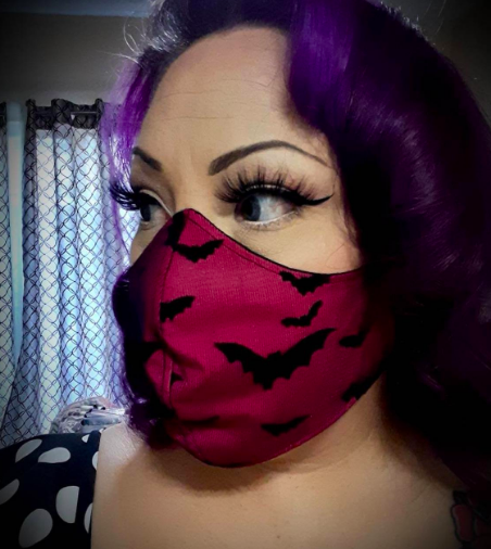 Red face mask with black bat pattern