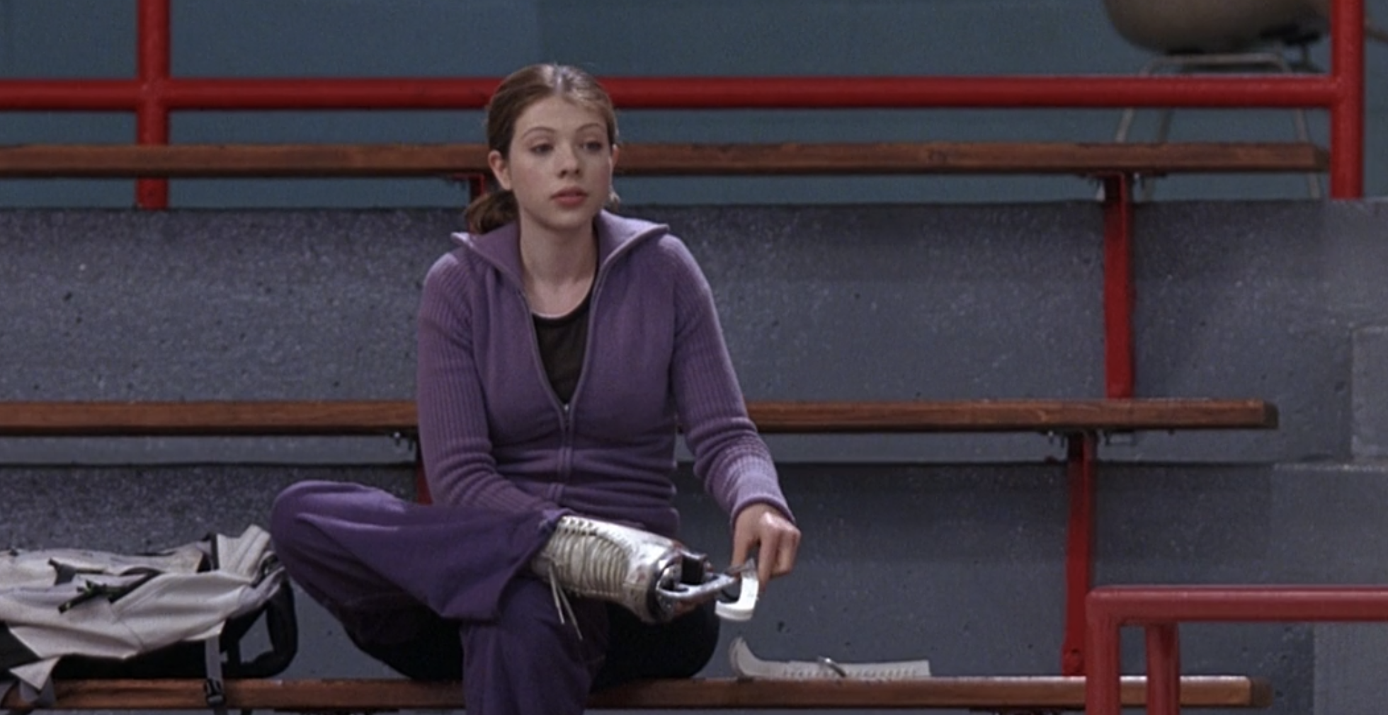 """Michelle Trachtenberg removes her ice skates as Casey in """"Ice Princess"""""""