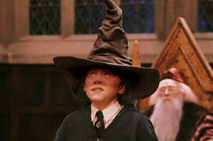 Ron sitting in the Great Hall wearing the Sorting Hat.