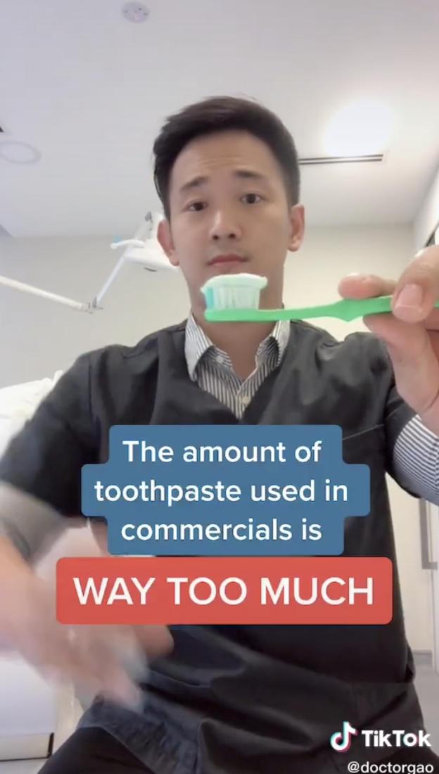 Dr. Gao demonstrating that the amount of toothpaste shown in commercials is way too much.