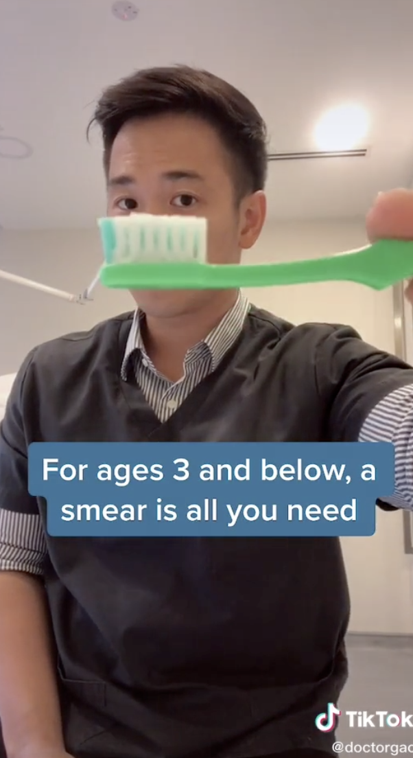 Photo of Dr. Gao holding a toothbrush from his TikTok.