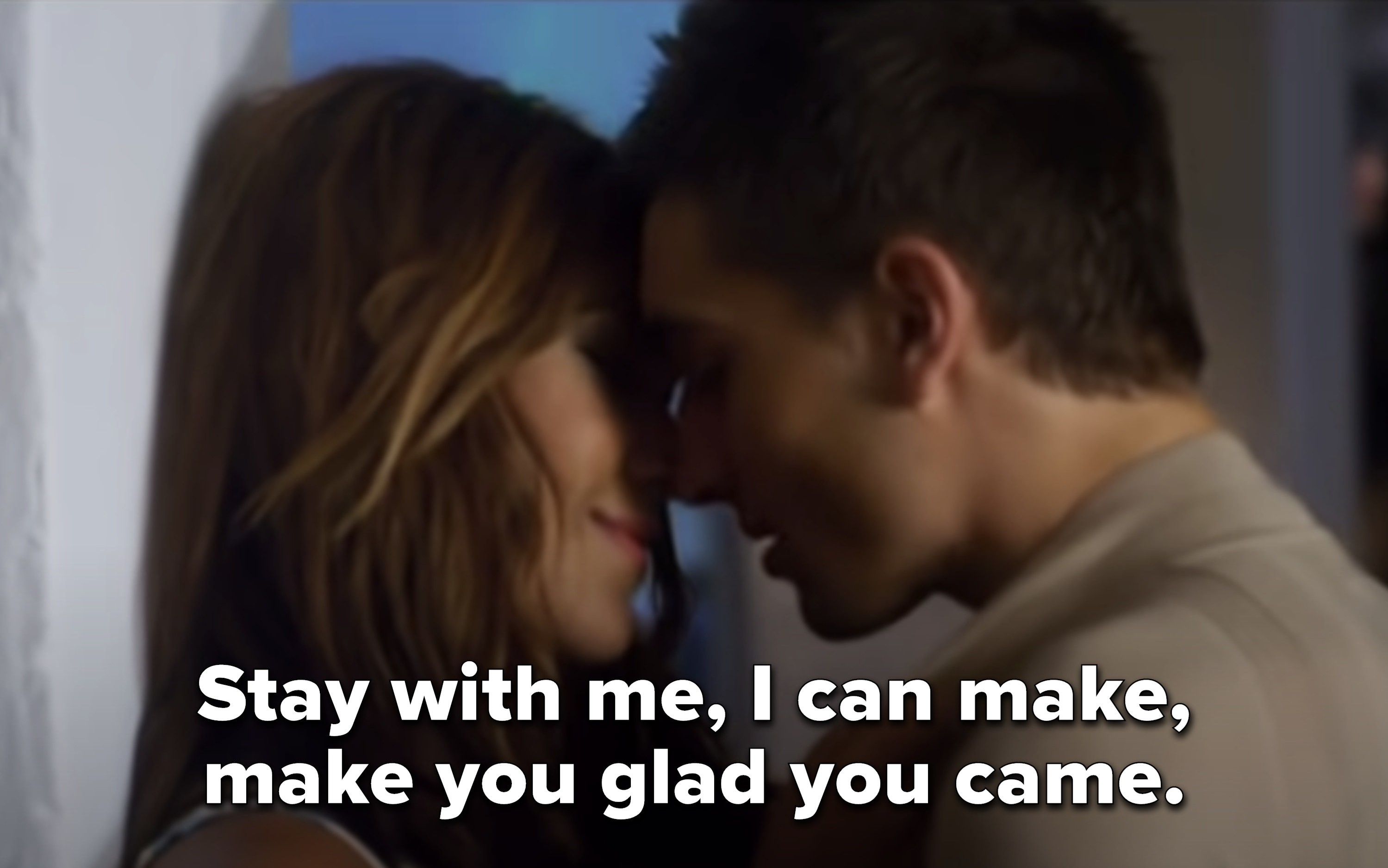 """a man and a woman are about to kiss while the song lyrics say """"Stay with me, I can make, make you glad you came"""""""