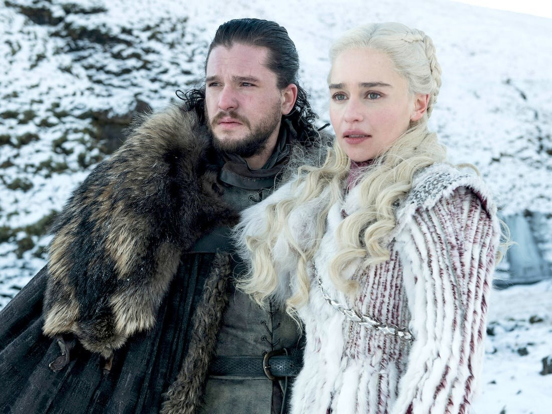 Jon and Daenerys standing together in the snow, looking into the distance
