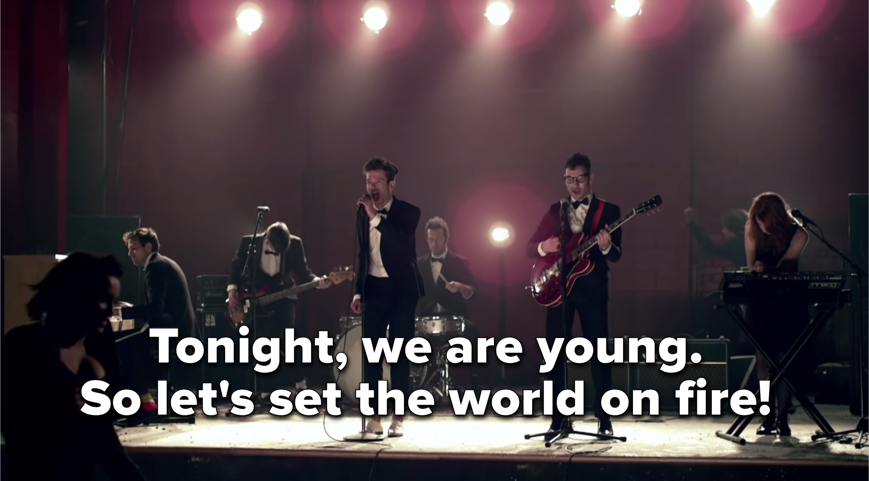 """Fun. onstage singing """"Tonight, we are young. So let's set the world on fire!"""""""