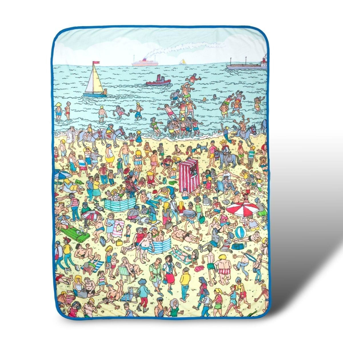 The blanket with a beach-themed Where's Waldo scene