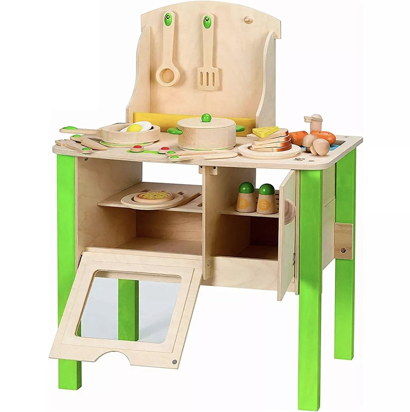 A green wooden kitchen playset