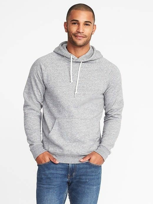 Model wearing the hoodie with blue jeans