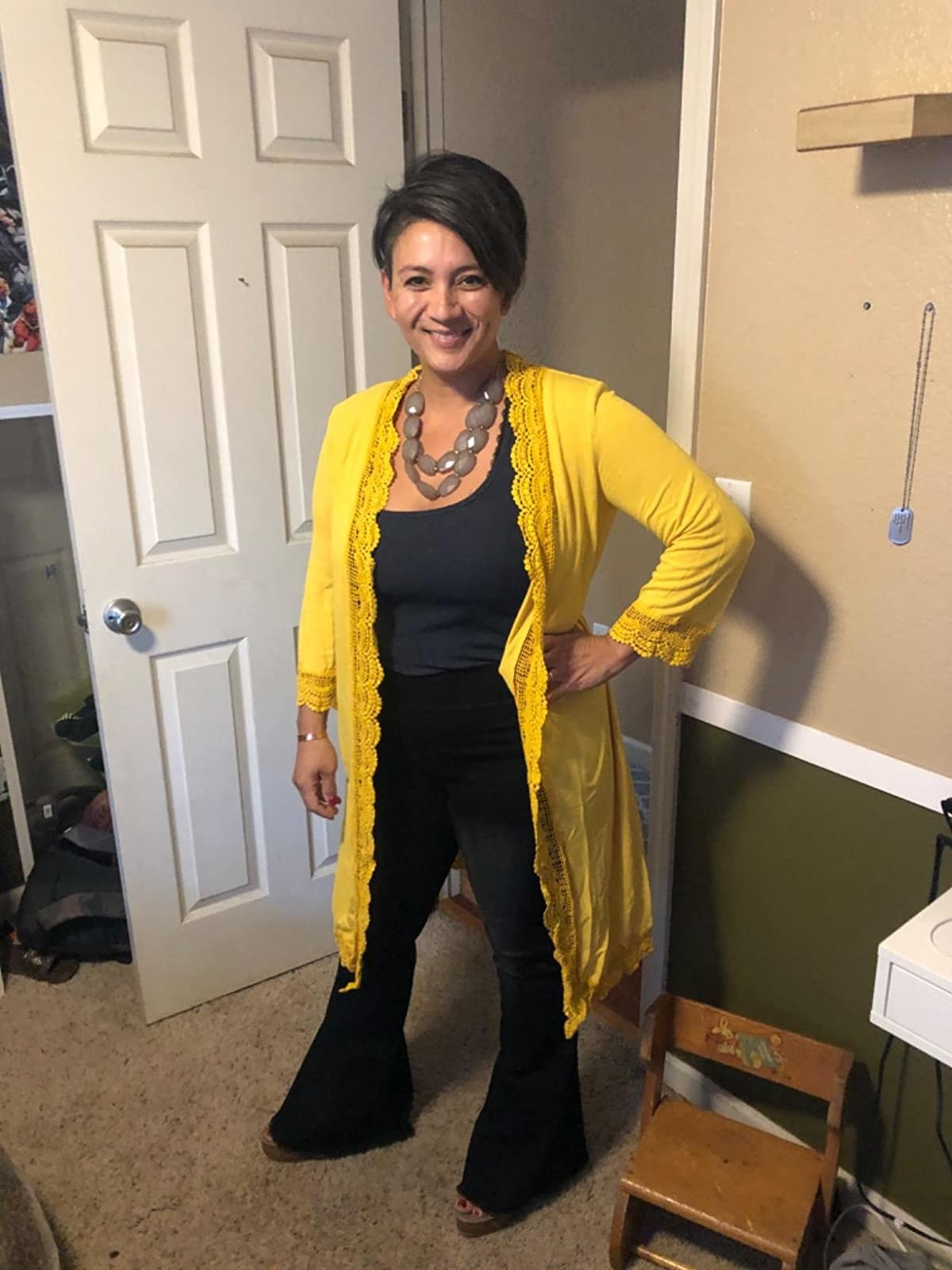 Reviewer wearing the knee-length cardigan in yellow